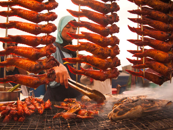Ibu Sayap Ayam Bakar (Mrs BBQ Chicken Wings) at Kota Kinabalu's incomparable night market. She's also doing ikan bakar (bbq fish) Chicken Wings Kota Kinabalu Barbecue Barbecue Grill Close-up Day Food Food And Drink Freshness Grilled Hanging Heat - Temperature Kebab Meat Night Market No People Outdoors Pork Preparation  Ready-to-eat Skewer Food Stories Visual Creativity