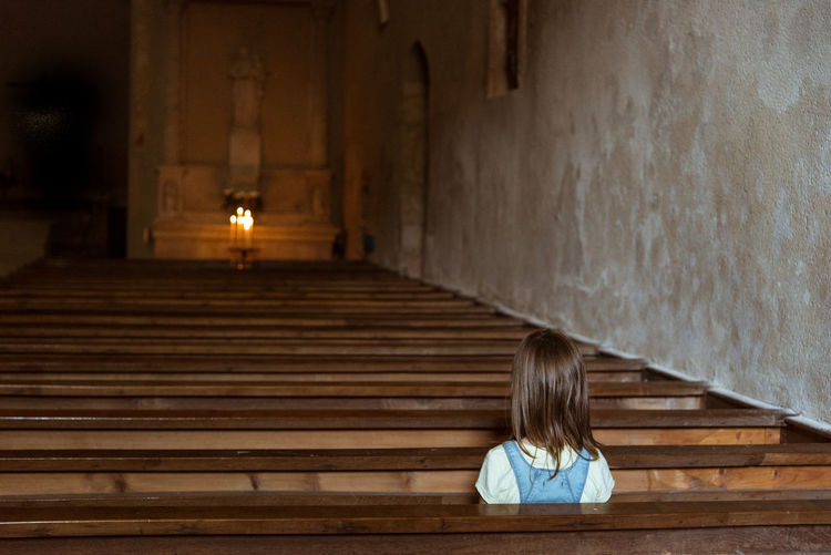Girl Sitting In Church