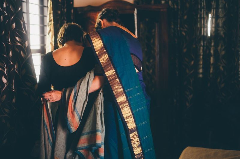 Connected By Travel Rear View Indoors  Real People Casual Clothing One Person Standing Lifestyles Women Curtain Day Young Adult Adult Adults Only People India Sari