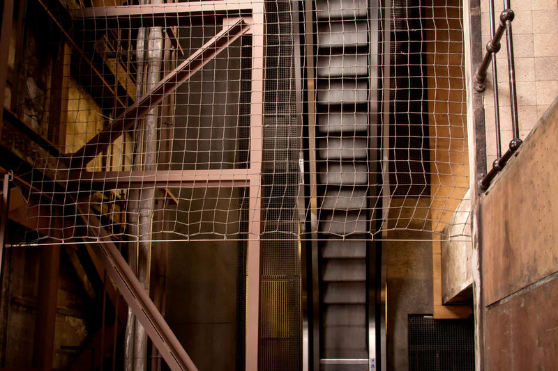 Low angle view of escalator in industry