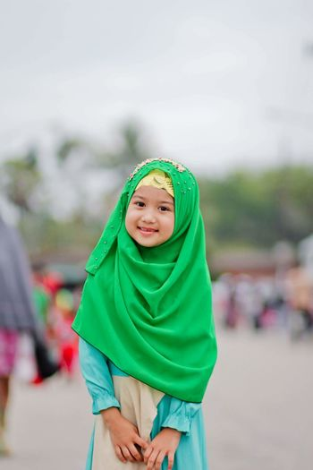 Portrait of innocent girl wearing green hijab
