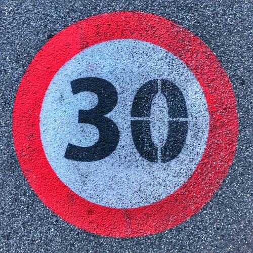 Red No People Close-up Multi Colored Outdoors Road Day 30 Sign asphalt Conceptual work market Aging age Social Issues speed Texture background