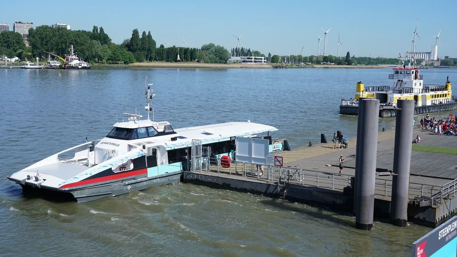 Ferry Terminal Ferryboat Ferry Ship Wharfside Wharf Landing-stage River Water Transportation Mode Of Transportation Nautical Vessel Nature Sky Day Incidental People Architecture Built Structure Group Of People Clear Sky Moored Outdoors Sunlight