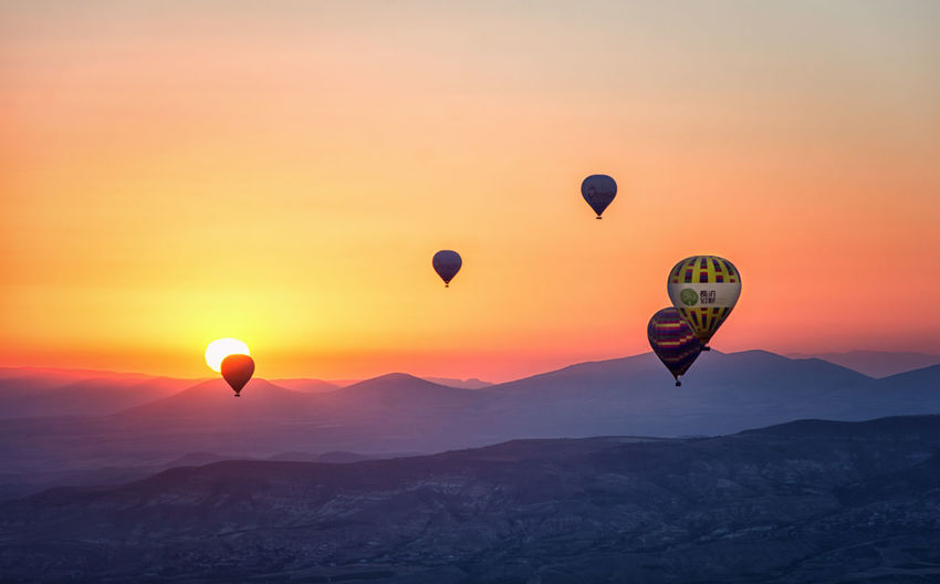 Adventure Air Vehicle Balloon Ballooning Festival Beauty In Nature Day Flying Hot Air Balloon Landscape Mid-air Mountain Nature No People Outdoors Rock Hoodoo Scenics Sky Sunrise_sunsets_aroundworld Sunset Traditional Festival Tranquil Scene Transportation Travel Destinations