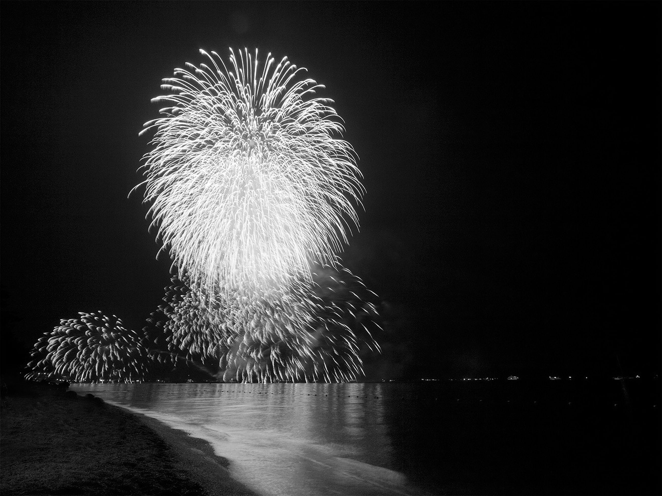 night, illuminated, firework display, long exposure, exploding, glowing, motion, celebration, firework - man made object, sparks, clear sky, arts culture and entertainment, sky, blurred motion, firework, low angle view, copy space, outdoors, event, entertainment
