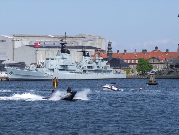 Danish Warship Blue Sky Boat Capital City Composition Copenhagen Danish Flag Denmark Grey Colour Navy No People Outdoor Photography Ripples In The Water Sea Ship Spray Tourism Tourism Malaysia Tourist Attraction  Tourist Destination Travel Destinations Warship Water Water Splash Waterfront