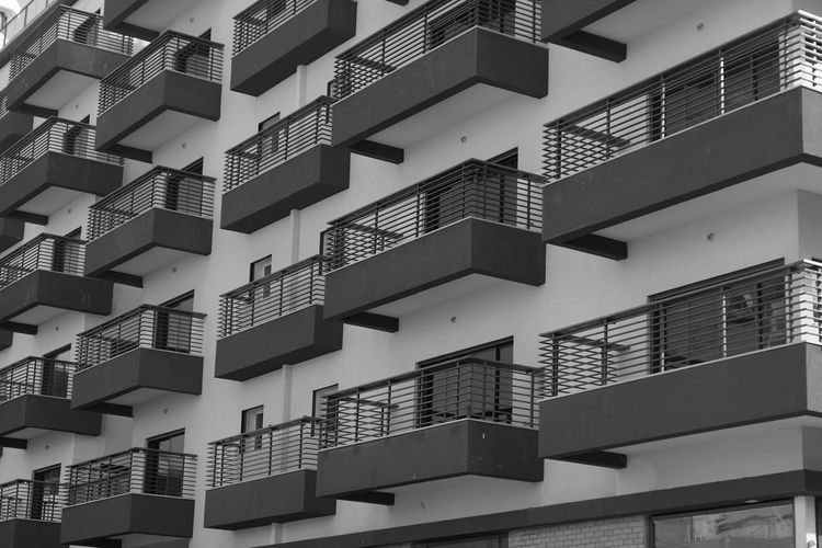 Architecture Built Structure Building Exterior Building Full Frame Backgrounds No People Day Repetition Pattern Window In A Row Balcony Residential District Outdoors City Wall - Building Feature Low Angle View Apartment