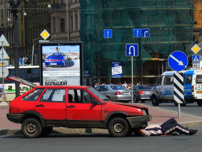 2005 Russia St Petersburg Traffic Architecture Building Exterior Built Structure Car City Day Outdoors Red Color Reparing Car Road Transportation Under The Car