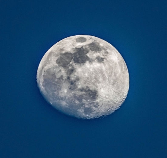 Scenic view of moon against blue sky