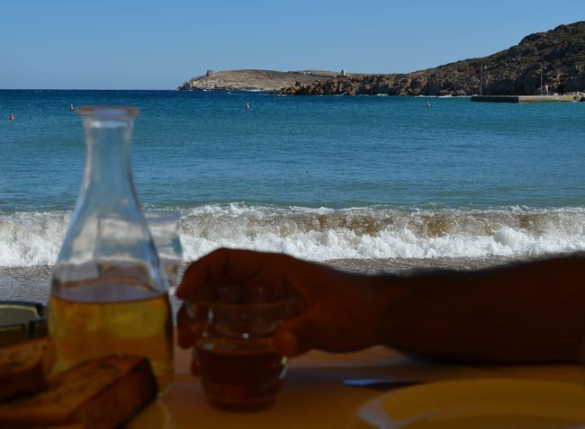 Simple pleasures of life Beach Coastline Escapism Focus On Background Greece Hand Kimolos Sea Seascape Shore Simple Life Simple Living Simplicity Summer Vacation Vacations View Wave Wine Landscapes With WhiteWall Blue Wave Telling Stories Differently The Great Outdoors - 2016 EyeEm Awards