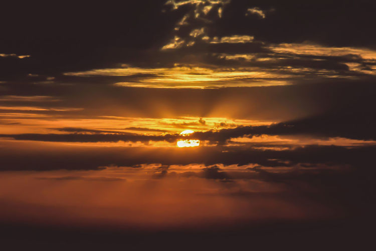 Stormy Weather Backgrounds Beauty In Nature Cloud - Sky Cloudscape Dramatic Sky Freedom Idyllic Meteorology Nature Orange Color Outdoors Scenics - Nature Sky Sun Sunlight Sunset