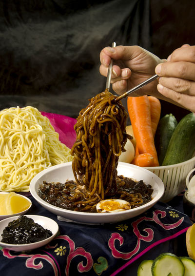 Black Noodles Cucumber Ingredients Korean Food Bowl Carrots Chopsticks Close-up Day Food Food And Drink Freshness Healthy Eating Human Hand Indoors  One Person People Table