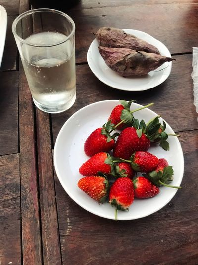 Close-up of strawberries in glass on table