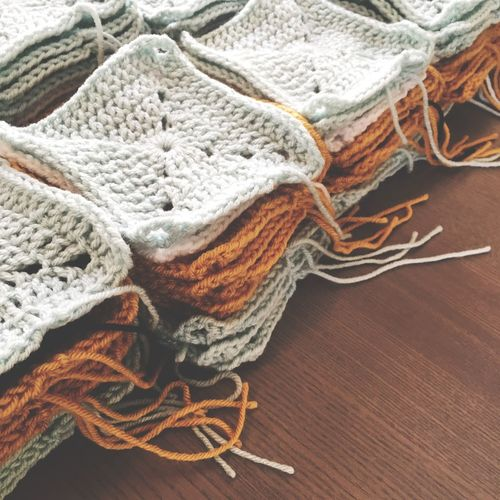 High Angle View Of Crochets On Wooden Table
