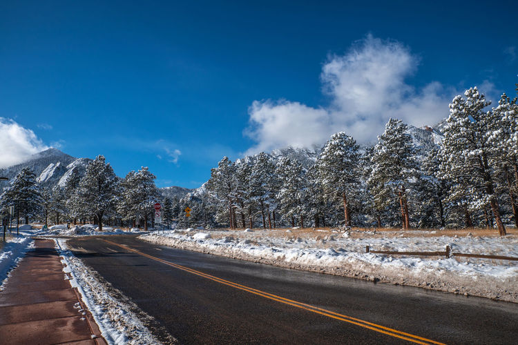 Boulder Colorado Boulder Snow Winter Wonderland Flatirons Rocky Mountains Colorado Tree Sky Road Plant Transportation Winter Cold Temperature Cloud - Sky Nature The Way Forward Direction No People Beauty In Nature Day Scenics - Nature Tranquility Non-urban Scene Tranquil Scene Outdoors Diminishing Perspective