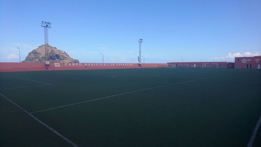 Football field. Garachico Tenerife SPAIN España Islas Canarias Canary Islands Football Field Football Field Soccer Pitch Green Blurry Foggy Simplicity Green And Blue Blue Sky Minimalism City Sky