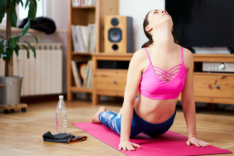 Midsection of woman sitting at home