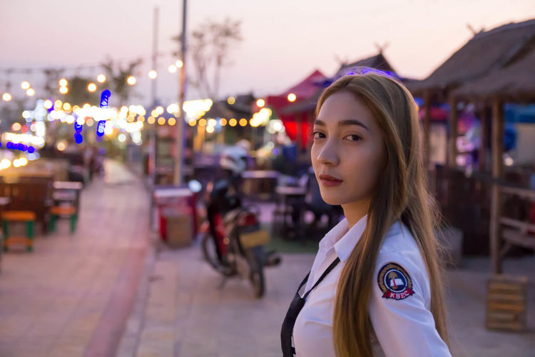 Portrait of sailor in city during sunset