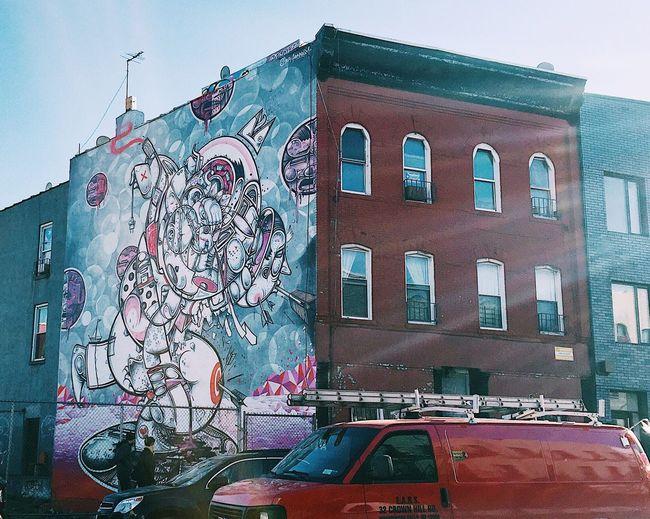 Graffiti on building against sky