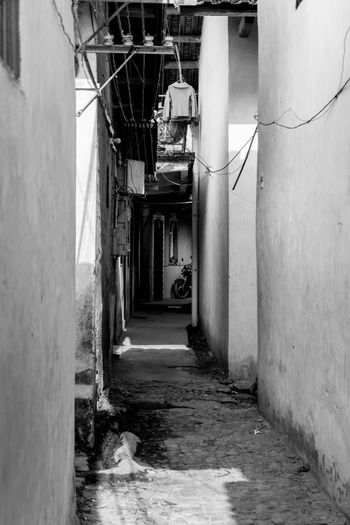Alley amidst buildings in town