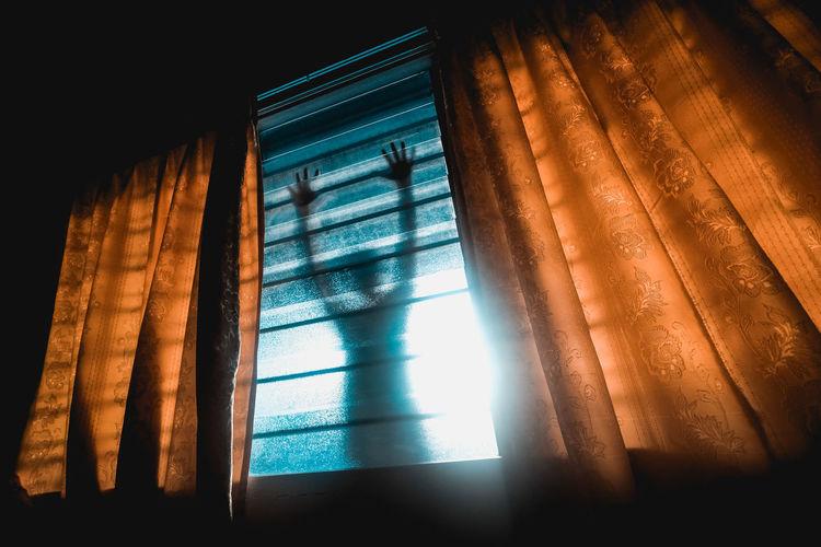 Person seen through window