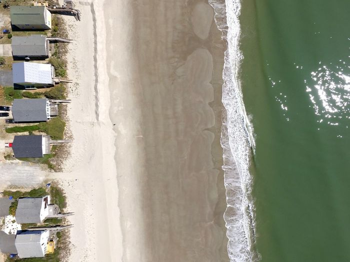 Aerial View Of Beach And Cabins During Sunny Day