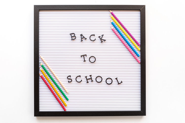 Back to school notice on message board Board Message White White Background Isolated School Education Class Back Lit To  Pencil Penchants Note Pad Communication Multi Colored Studio Shot Spiral Notebook Cut Out No People Text Paper Reminder Indoors  Black Color Business Organization Close-up Ring Binder To Do List