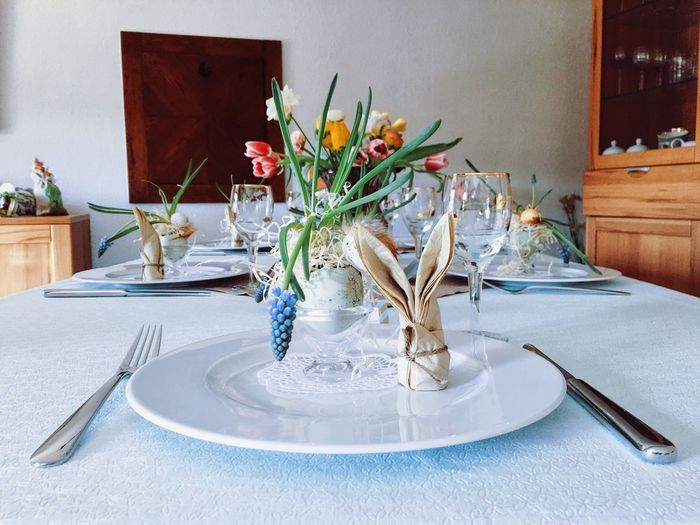 Eating utensils arranged on dining table at home