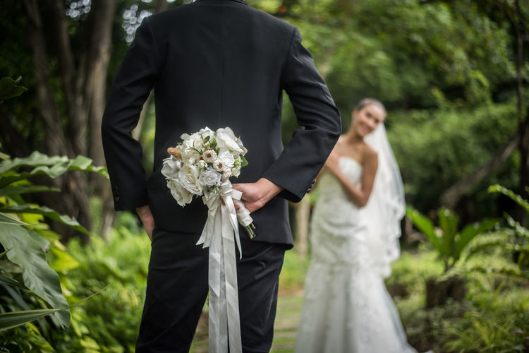Plant Flower Bride Flowering Plant Men Wedding Newlywed Wedding Dress Event Bouquet Flower Arrangement Nature Real People Adult Bridegroom Well-dressed Standing Two People Married Holding Couple - Relationship Outdoors Wedding Ceremony