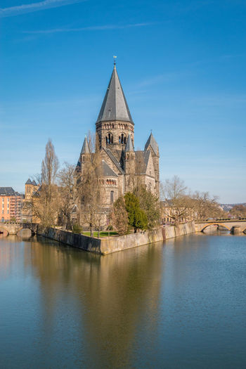 Temple de Neuf in Metz France France Metz Metz, France Architecture Belief Blue Building Building Exterior Built Structure Nature No People Outdoors Place Of Worship Reflection Religion Sky Spire  Spirituality Temple Temple De Neuf Travel Destinations Water Waterfront