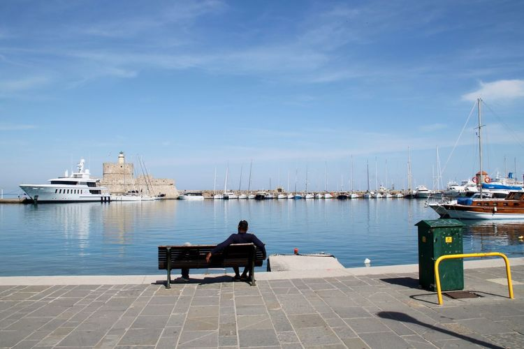 Architecture Beauty In Nature Enjoying The View Harbor Leisure Activity Men Mode Of Transport Moored Nature Nautical Vessel One Person People Rhodes Rodos City Ródos Sailboat Sea Seaside Sitting Transportation Water