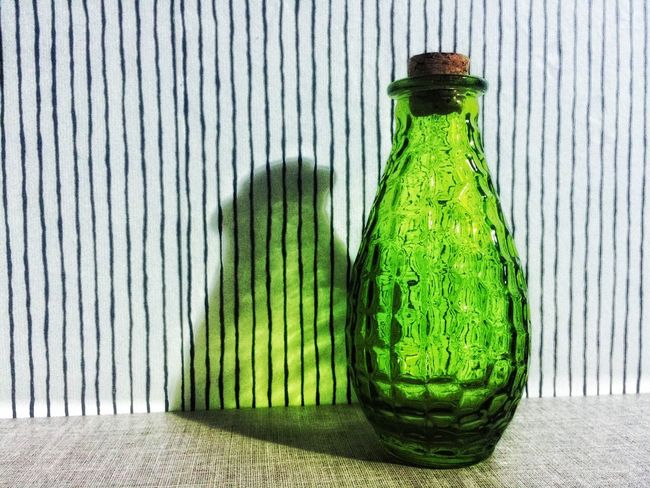 Enjoying Life IPhoneography Still Life Green Colors Iphonephotographyschool IPhone Photography Iphoneonly Snapseed Snapseededit Greencolor Green Color Green Green Green!  Green Bottles Bottle Bottles Collection Bottle Art Wall Colorful Shadows Shadow And Light