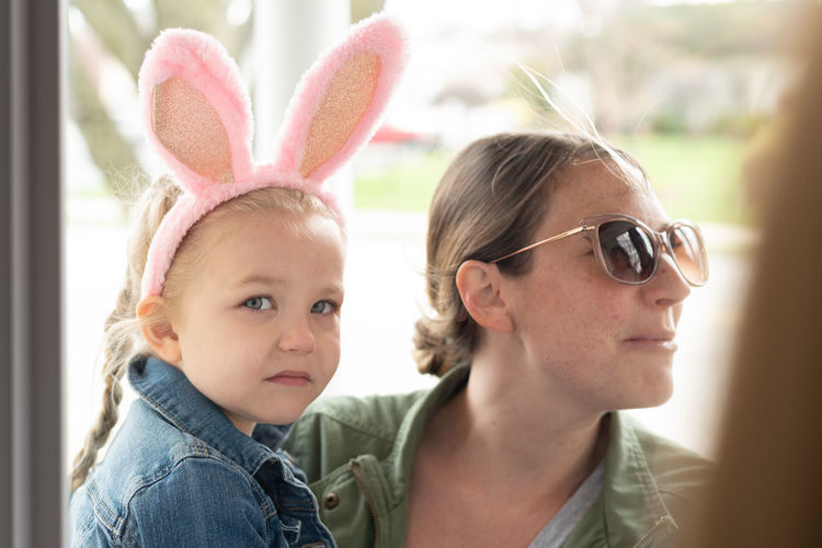 Close-up of girl wearing costume rabbit ears