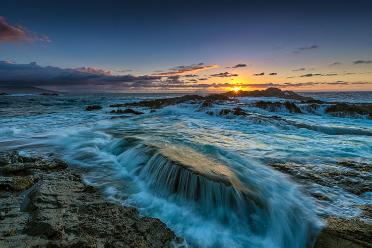 Falling tides Aquatic Sport Beach Beauty In Nature Cloud - Sky Dusk Flowing Flowing Water Land Long Exposure Motion Nature No People Ocean Outdoors Power In Nature Scenics - Nature Sea Seascape Sky Sport Sunset Tranquil Scene Tranquility Water Wave