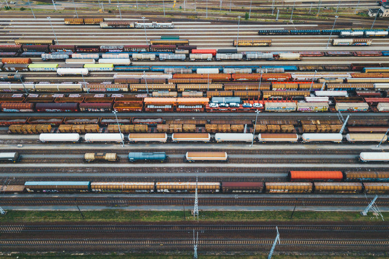 A large marshalling yard filled with freight trains in a horizontal pattern