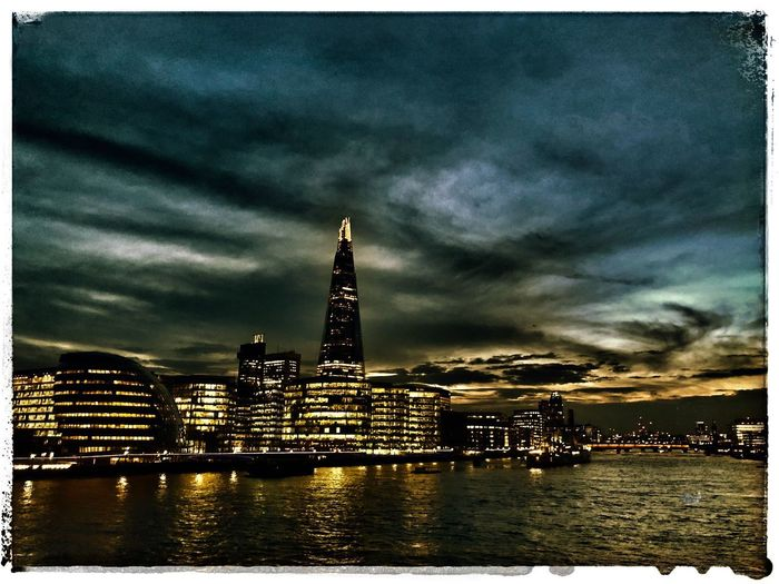 Moody blues - a cityscape ShotOnIphone IPhoneography Blue Moody Uk London Shard Lights Water Architecture Sky Cloud - Sky Built Structure Illuminated Building Exterior Waterfront No People Night Nautical Vessel Outdoors River Travel Destinations Cityscape Urban Skyline City