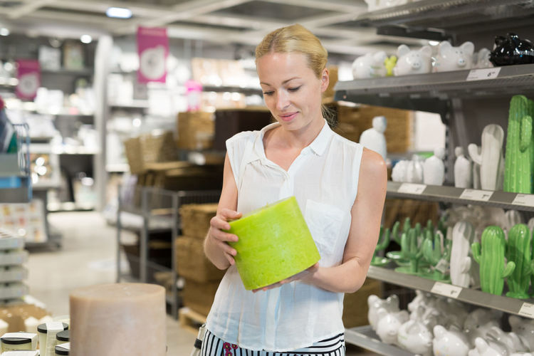 Midsection of woman standing in store