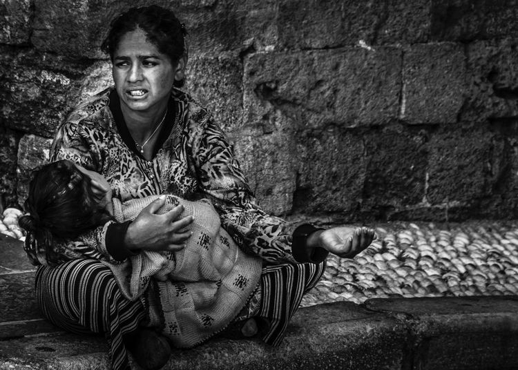 The future in mother's lap Child Day Future Homeless Cats Mother Outdoors Photolehner Poor  Poverty Sitting Pretty Starvation The Photojournalist - 2016 EyeEm Awards Withoutprospects