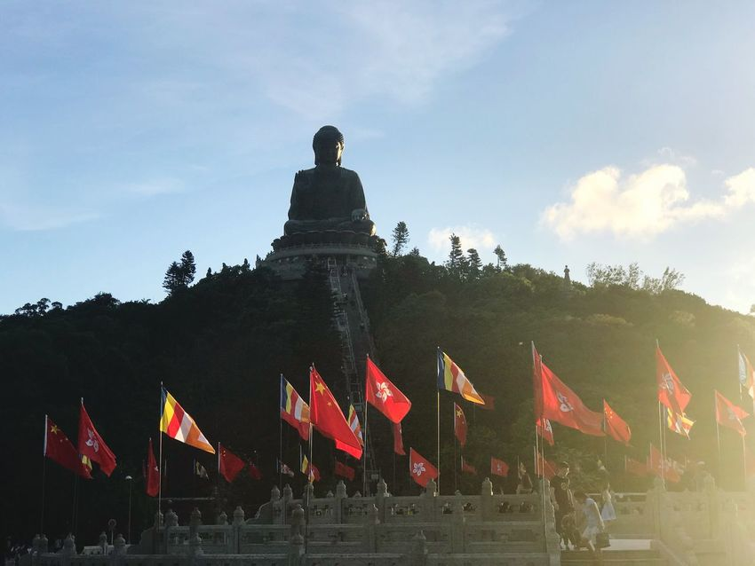 Flag Patriotism Sky Cloud - Sky Day Tree Pride Outdoors Architecture Large Group Of People Low Angle View Built Structure Building Exterior Real People Men People Bug Buddha HongKong Ngongpingvillage Tian Tan Buddha (Giant Buddha) 天壇大佛