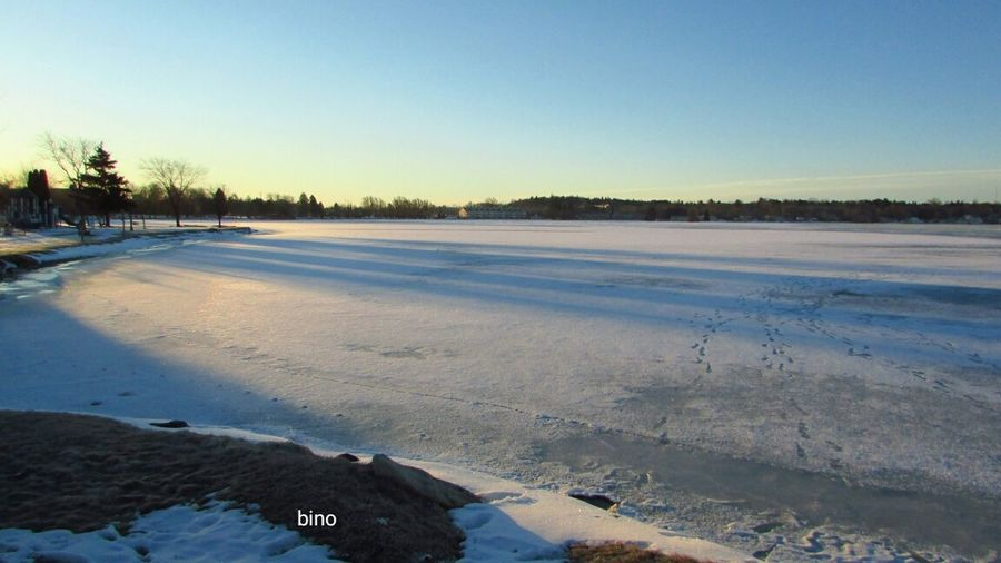 Early Morning Cold Temperature Half Of The Lake Still Snow Covered No People Shadow And Light Lake Cadillac Pure Michigan
