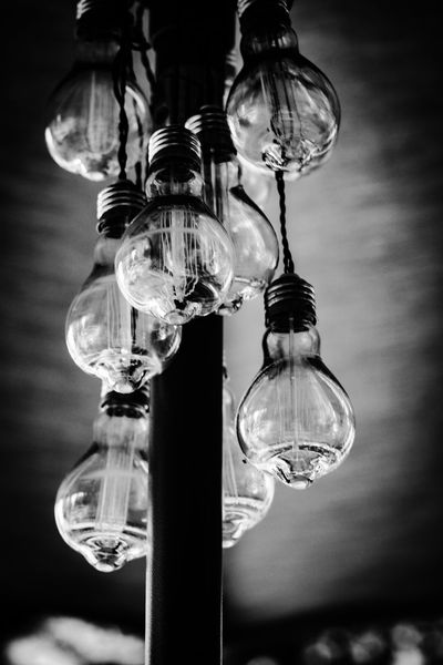Lights Hanging Electricity  Focus On Foreground Lighting Equipment Low Angle View Light Bulb Bulb Close-up No People Illuminated Filament Indoors  Technology Day