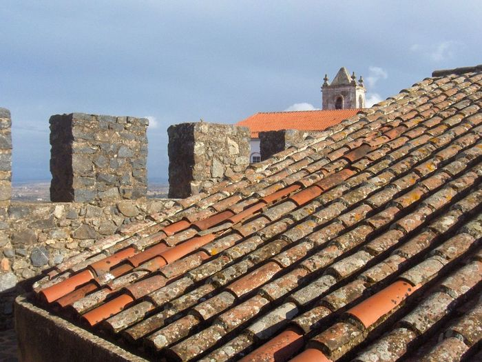 Algarve Architecture Brick Wall Building Exterior Built Structure Day History House Low Angle View Old Outdoors Place Of Worship Portugal Religion Roof Roof Roof Tile Rooftop Sky Stone Material Stone Wall Sunlight Tower Wall - Building Feature