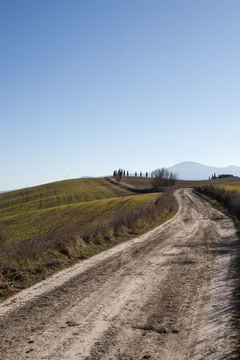 Sky Landscape Land Environment Field Nature Scenics - Nature Tranquil Scene Outdoors Road Clear Sky Copy Space Dirt Road Tranquility Transportation Direction The Way Forward Plant Dirt No People Day Crete Senesi Pienza Val D'orcia Tuscany Tuscany Hills Tuscany Countryside Cypresses Road