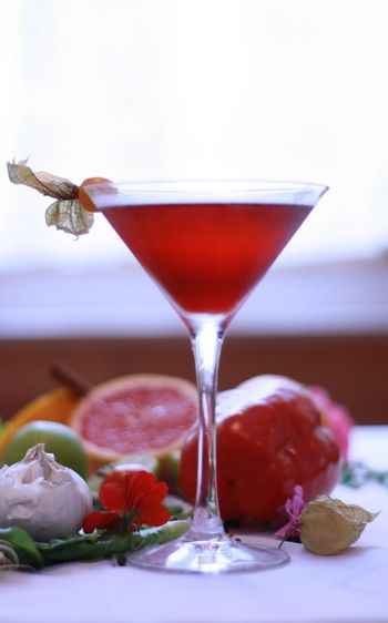Close-up of drink in martini glass on table