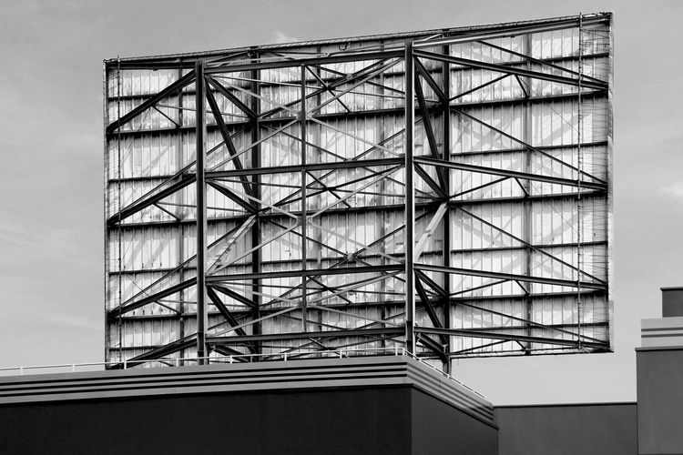 Billboard back AdvertisingMovie Lines Architecture Artphotography Backgrounds Billboard Blackandwhite Building Exterior Built Structure Day Diagonals Frenchphotographer Low Angle View No People Outdoors Photographer Sky