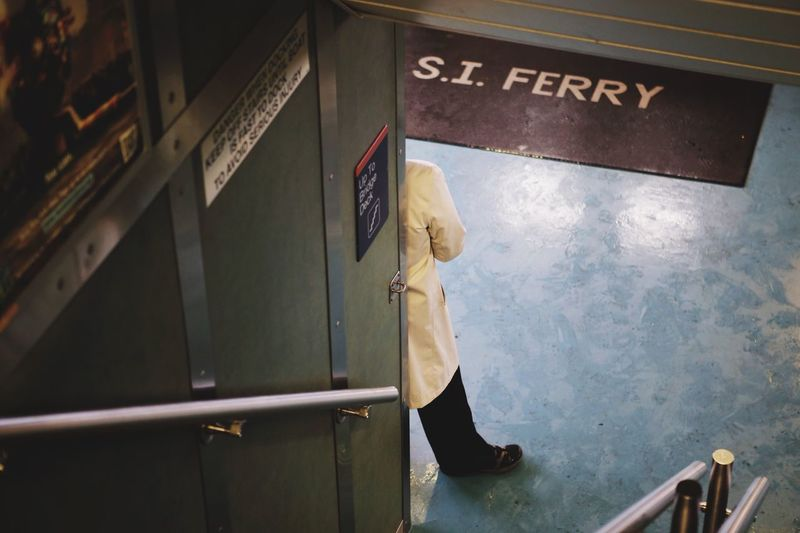 Text Communication Real People One Person Indoors  Day Full Length Man Man In Trenchcoat Trenchcoat Spy Ferry Staten Island Ferry New York Low Section People