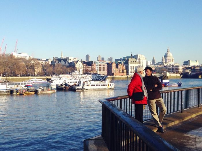 River Thames London Couple Blue Red River Everyday Joy I just liked a couple standing with their back toward the river while they're chatting. And I liked the delicate harmony of the red and blue.