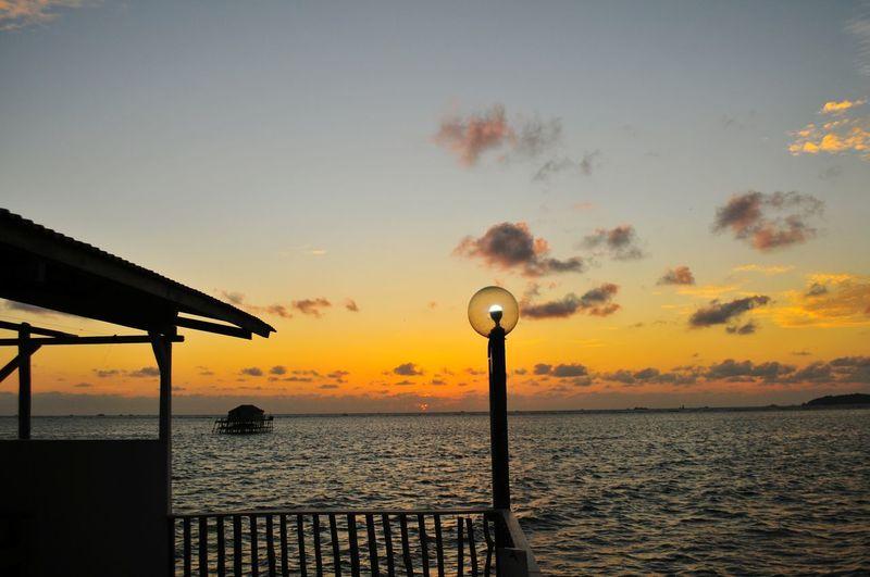 Morning Light Morning Orange Illustration Warm Summer Sunlight Sunrise_sunsets_aroundworld Sunrise Lamp Lamp Post EyeEm Selects EyeEmBestPics Water Sea Sunset Beach Silhouette Sky Horizon Over Water Seascape