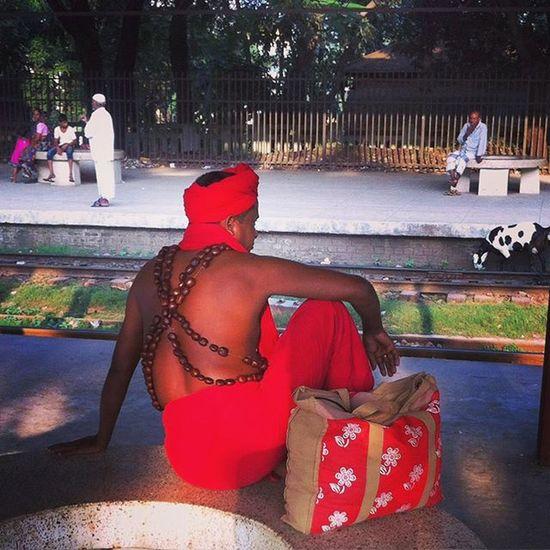A Hindu devotee waits for train at Comilla railway station. Lategram Js Jashimsalam Photos Photographer Photojournalist Photojournalism Documentary Dailylife Train Rail Station Railway Fotomobile Devotee Wait Red Garua Natgeo People Street Instagram Opensociety Layer @instagramcomillaeverydaybangladesh