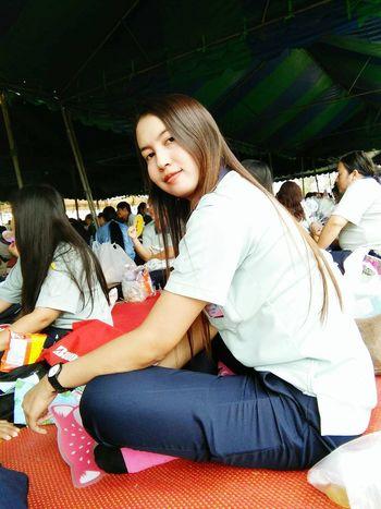 Young Women Sitting Full Length